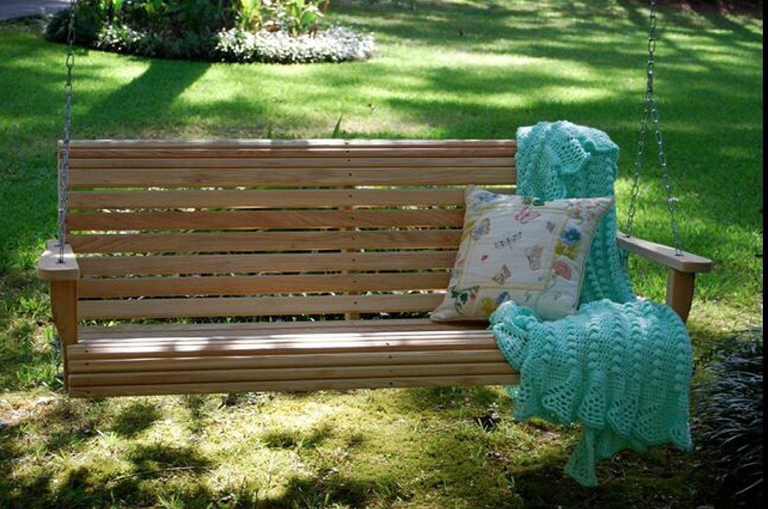 Unfinished wooden rollback porch swing