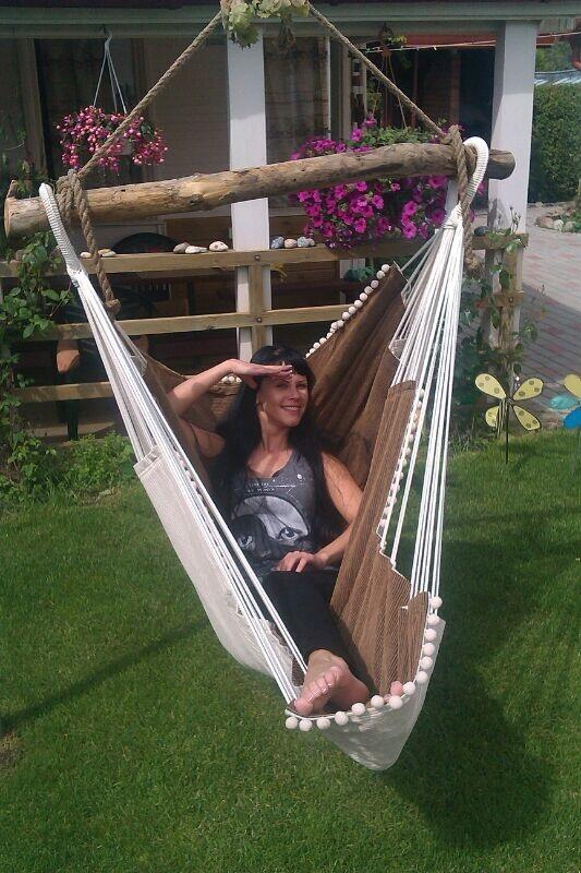 chilling-out-in-a-handmaid-hammock-chair-in-the-garden