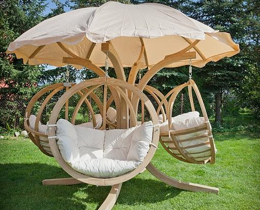 Wooden Round Chairs hanginfg froma a wooden stand-Quadro-