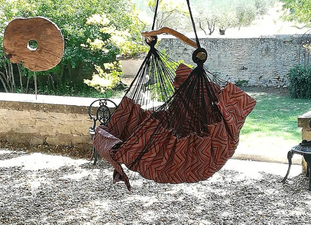 Bohorocker bohemian hammock rocking chair in garden by Philip Cooper Outdoor- designer hanging chair