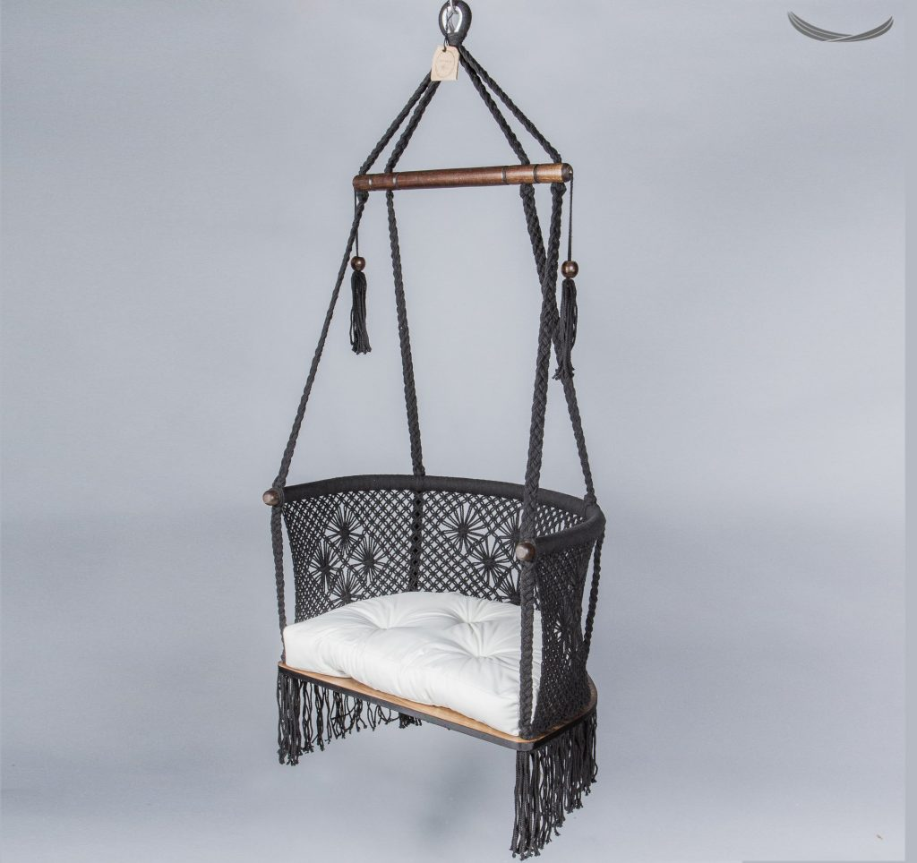 Handmade Macramé Adult Chair in Black whit a white cushion Designed by Hang a Hammock Collective