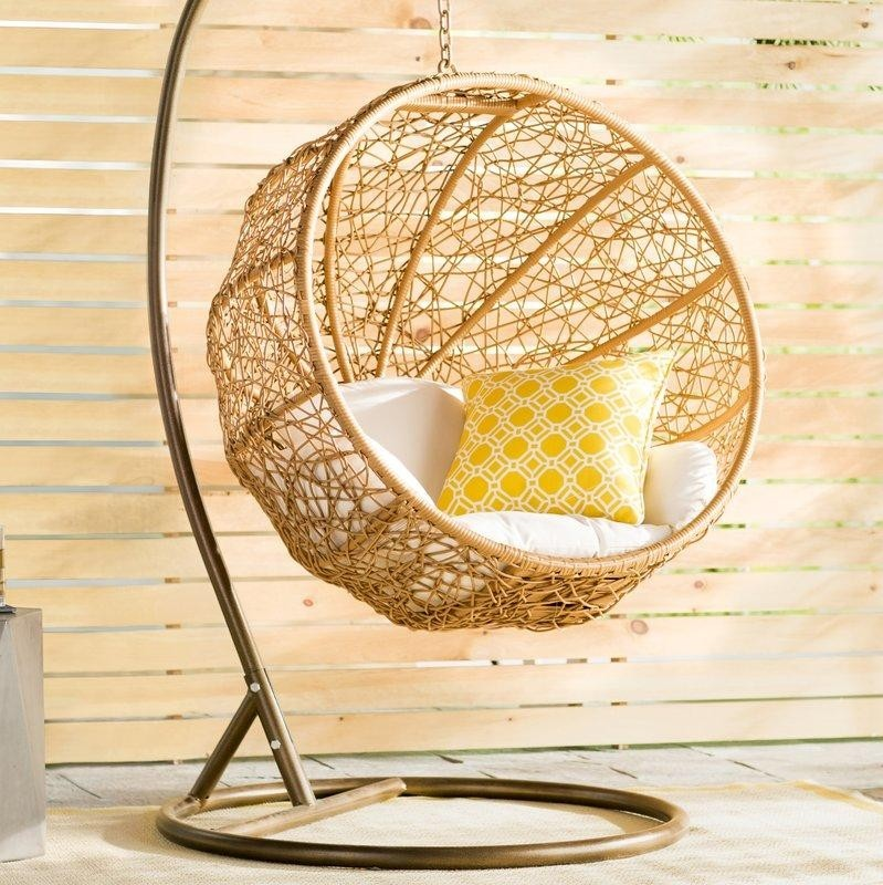 Eliott Swing Ball Wicker Chair with Stand and white and yellow cushion
