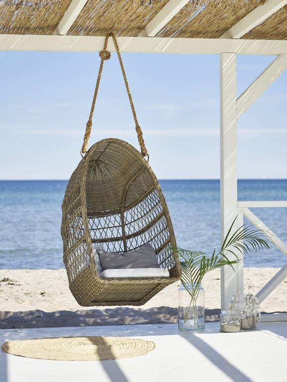 Evelyn-Outdoor-Swing-Basket-Chair-on-the Beach