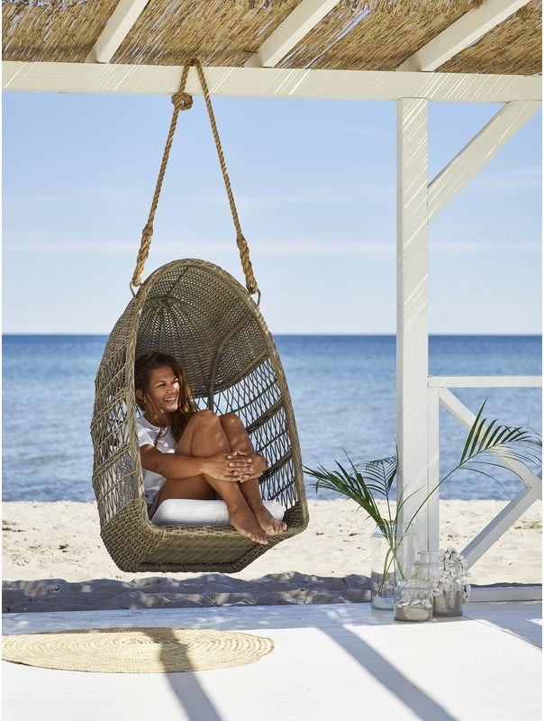 Evelyn-Outdoor-Swing-Basket-Chair-on-the-Beach