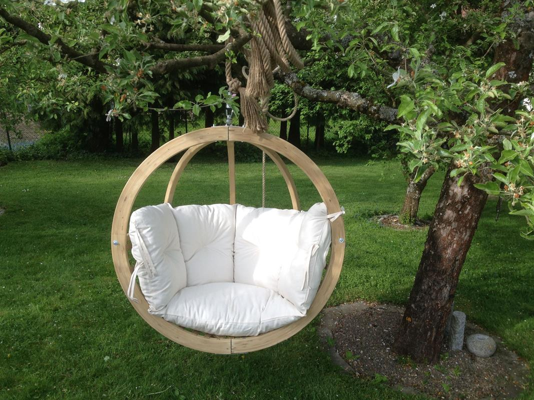 Globo-wooden-hanging-chair-hanging-on-tree