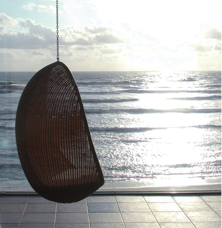 rattan-basket-egg-chair-nanna-ditzel-sea-sunset