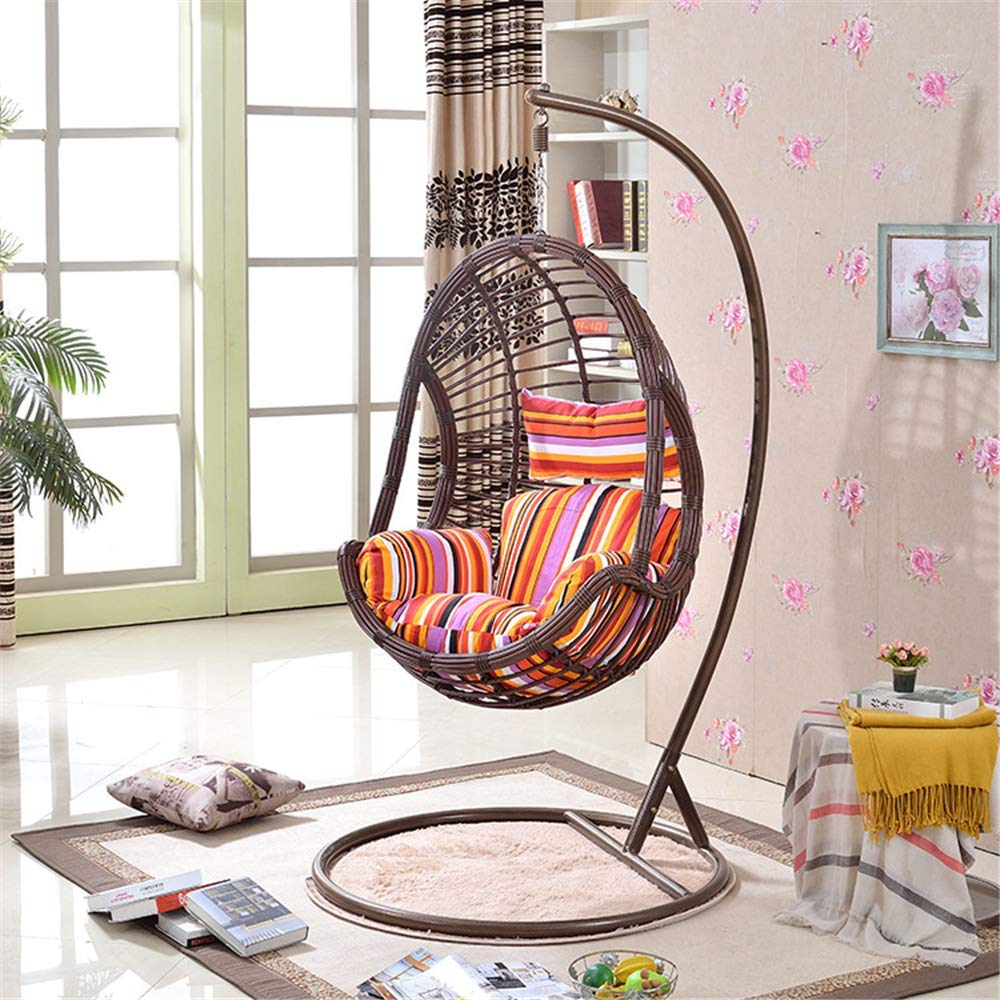 wicker-hanging-egg-chair-hammock-with-stand-in-living-room-with-colorful-cushion