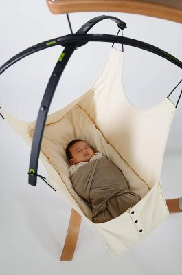 baby-is-sleeping-in-a-hammock-cradle-with-stand-organic-cotton-swing