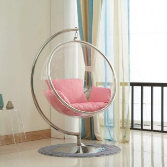 Bubble chair replica with a pink cushion and stand for bedroom