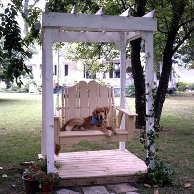one seater arbor patio swing and the dog