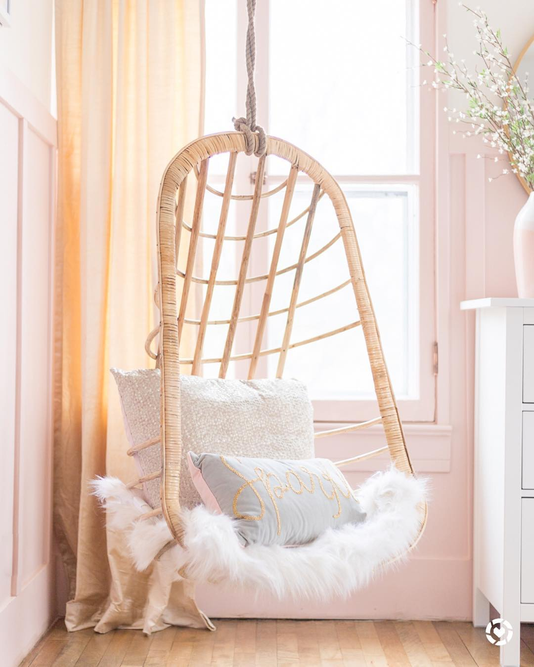 Pink and Gold Girls Bedroom swing rattan chair with cushions