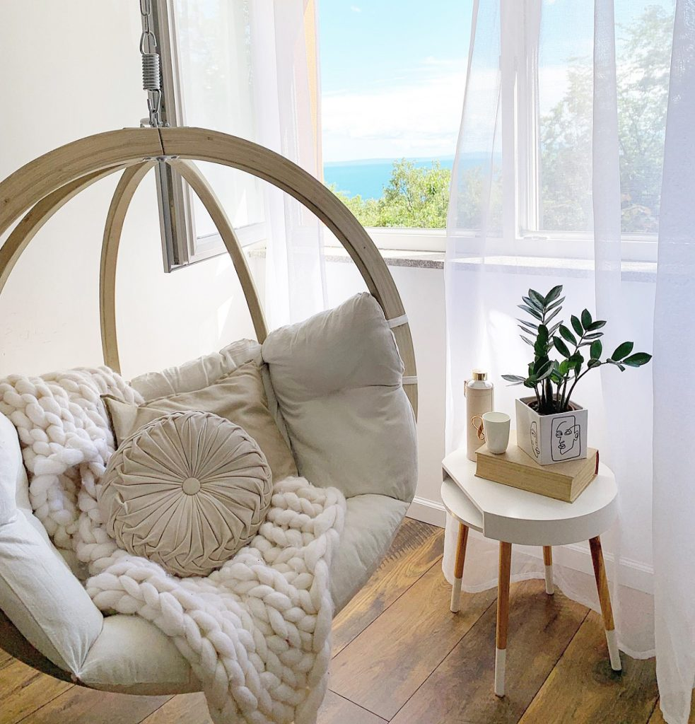 wooden-swing-hanging-in-the-corner-of-living-room-view-on-adriatic-sea-Valentina