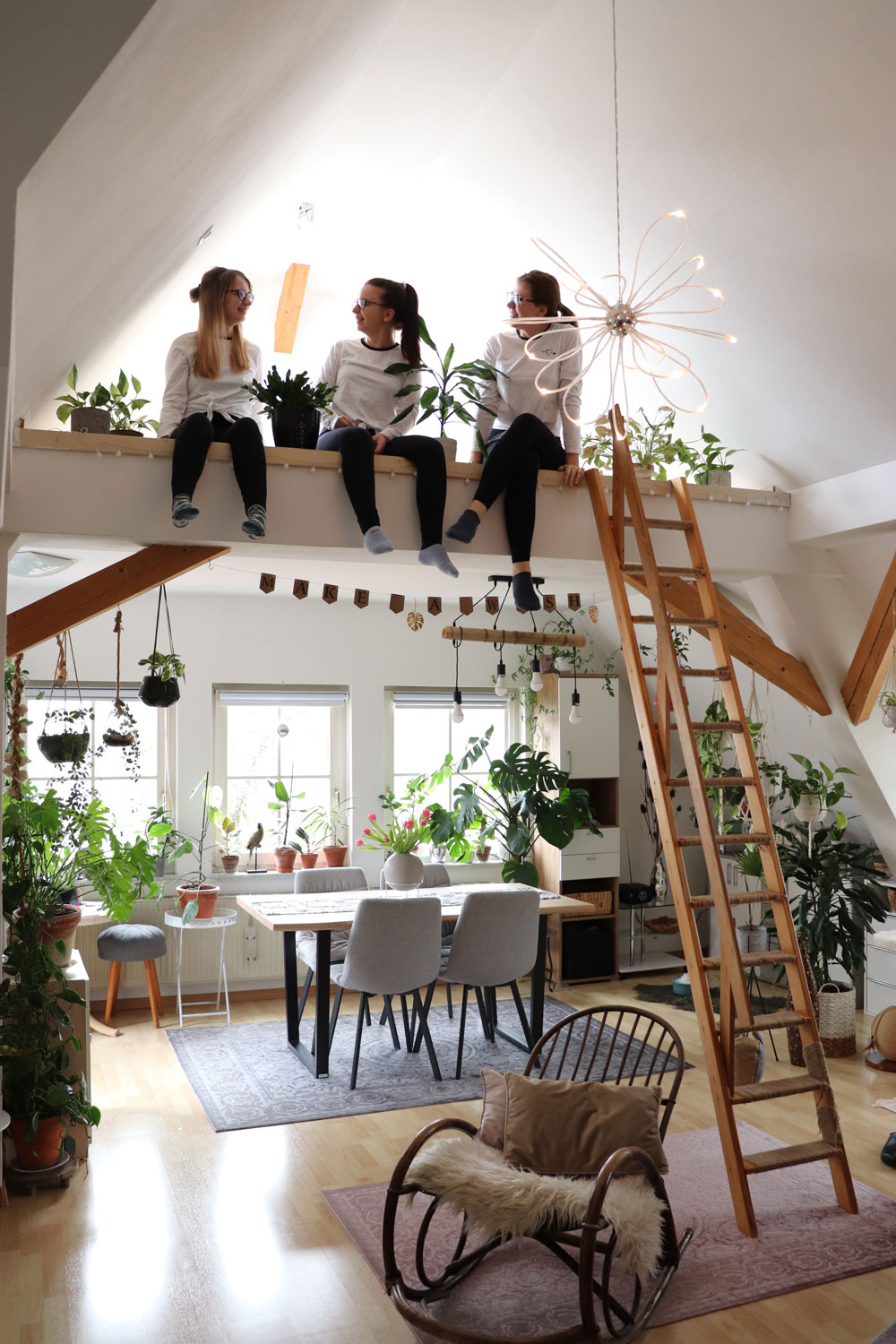 Kristinas-friends-sitting-on-loft-boarding-in-her-lovely-jungle-appartment