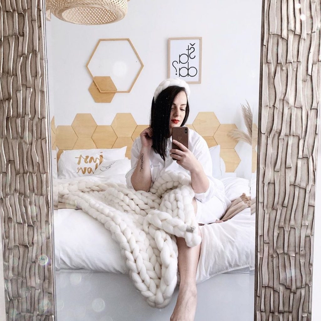 Valentina-sitting-in-her-bed-submission-for-hanging-chair-house-tour