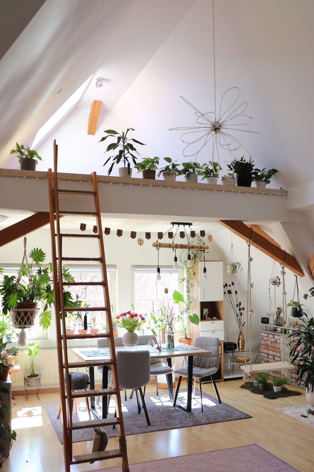 open-living-room-space-with-plants-ladder-and-diy-swing-Kristinas-submission