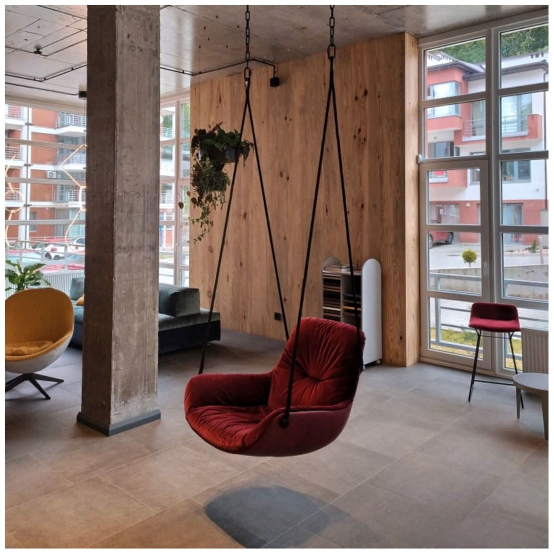 dark-red-hanging-seat-hanging-from-ceiling-designer-minimal
