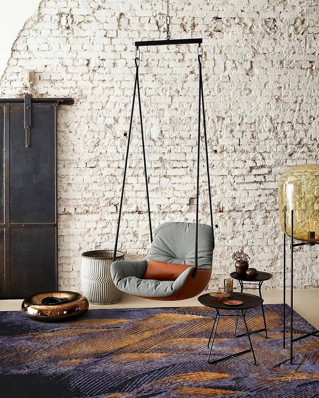 grey-swing-seat-hanging-from-ceiling