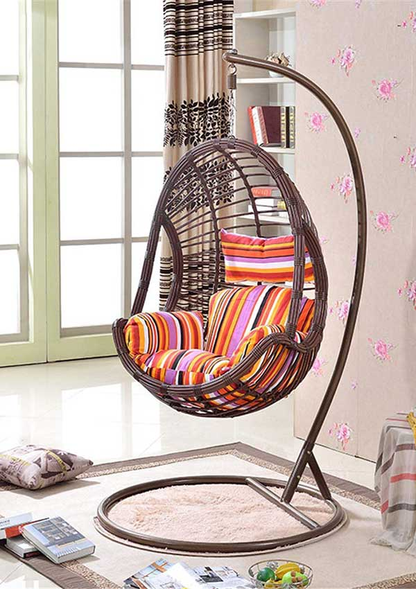 wicker-egg-chair-hammock-with-stand-in-living-room-with-colorful-cushion
