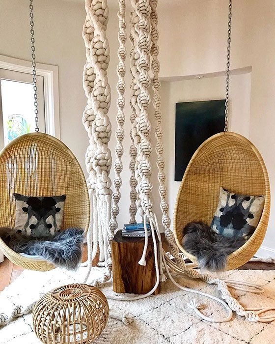 two-hanging-rattan-chairs-in-living-room-vintage